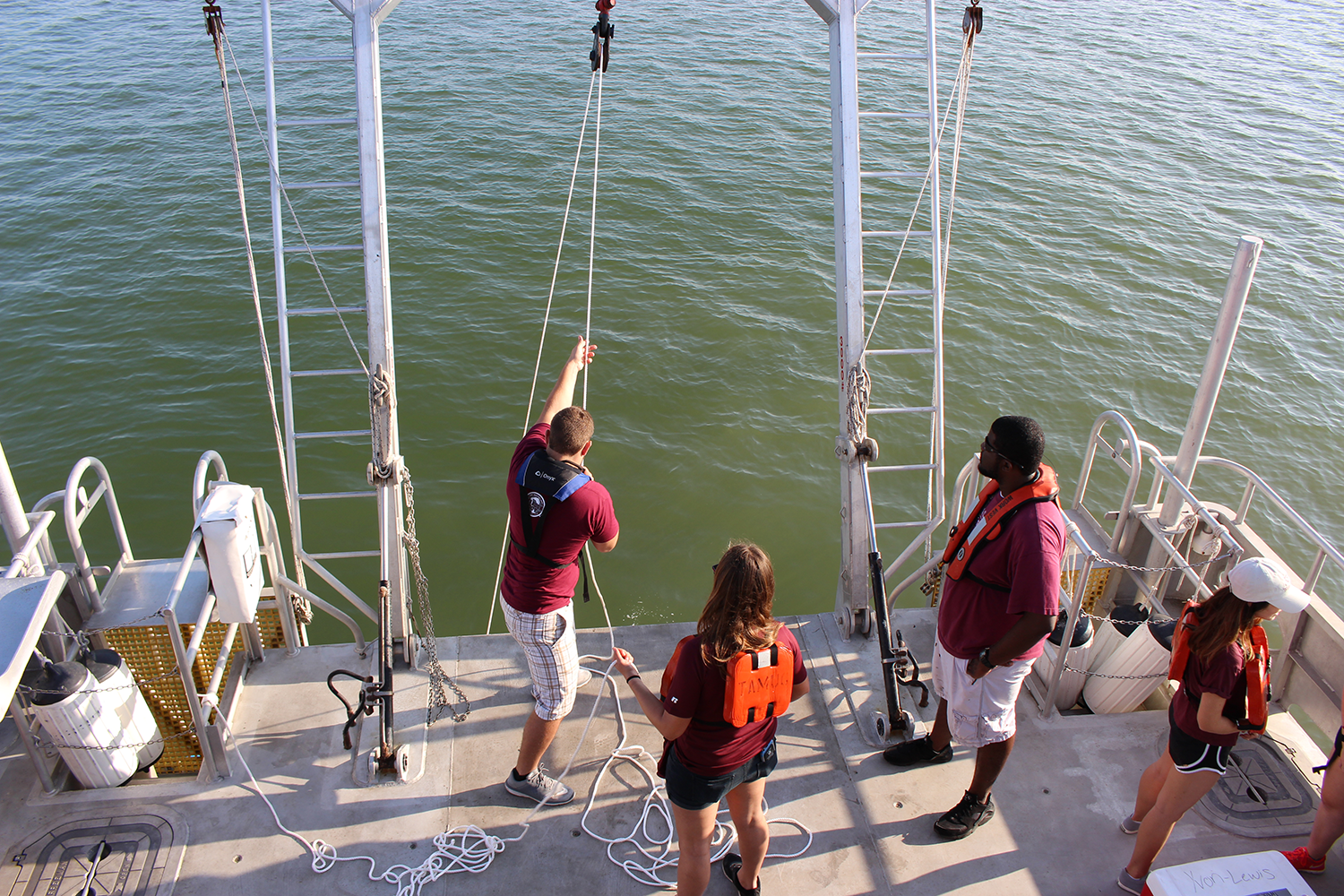 Oceanography students conducting research aboard the RV Trident Nov. 4.