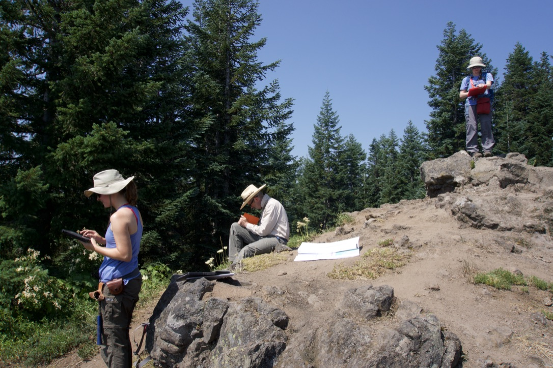 TAMU M.S. student Maria, Oregon State University professor Andrew Meigs, and TAMU undergraduate student Sarah doing field work in the Cascades, Oregon (Photo credit: Dr. Nick Perez)