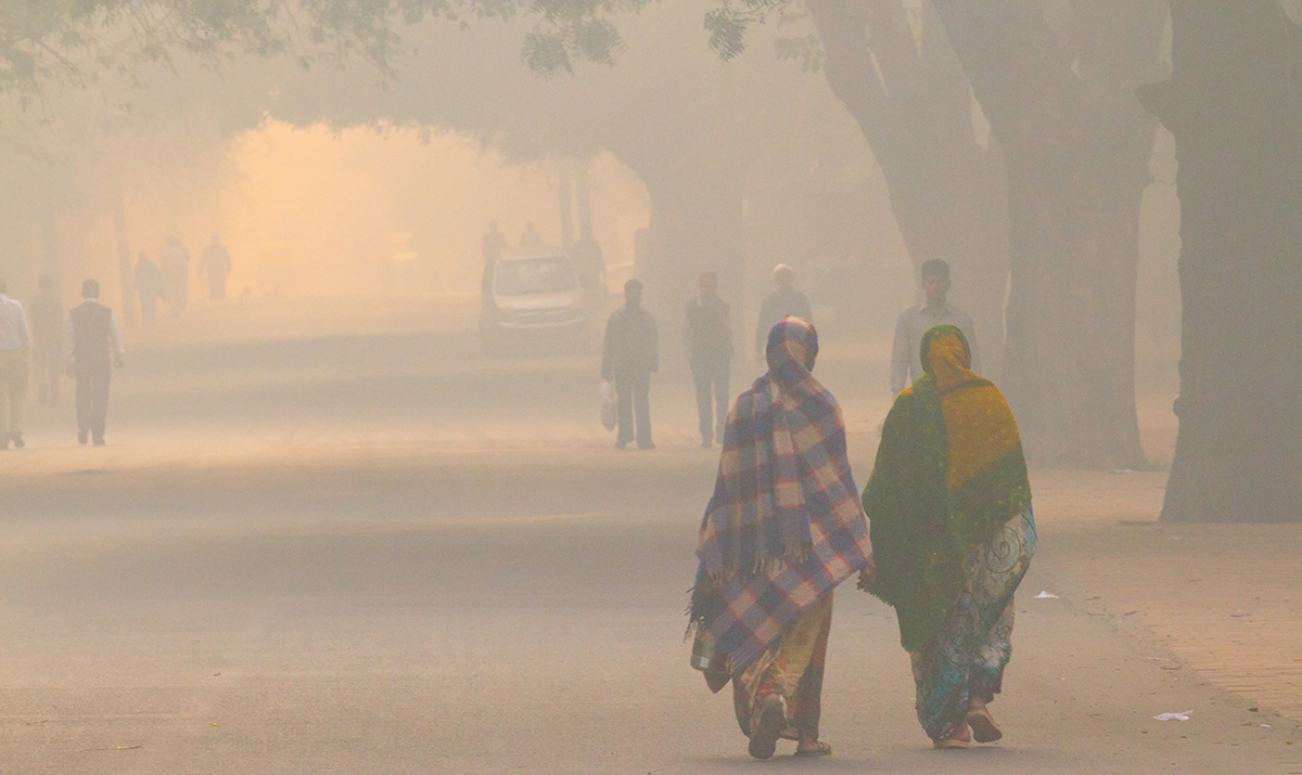 Daily street life in the early morning during extreme smog conditions, in New Delhi, India in 2012. (Photo courtesy of iStock/Getty.)