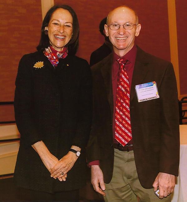 Grossman with AAAS Chair of the Board Margaret A. Hamburg after receiving his AAAS Fellows certificate and rosette during the Fellows breakfast.