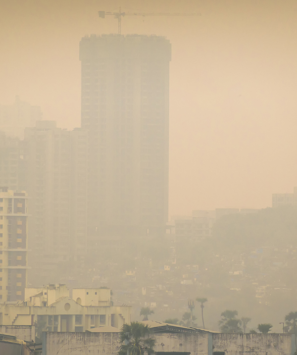 Mumbai, Maharashtra, India - October 2019: High air pollution and haze envelops the high rises in the suburb of Kandivali East. (Photo courtesy of iStock/Getty.)