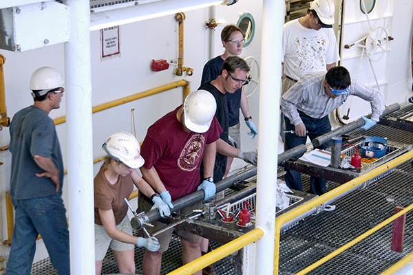 A sediment core being processed on the deck of the JOIDES Resolution. (Image courtesy of IODP.)