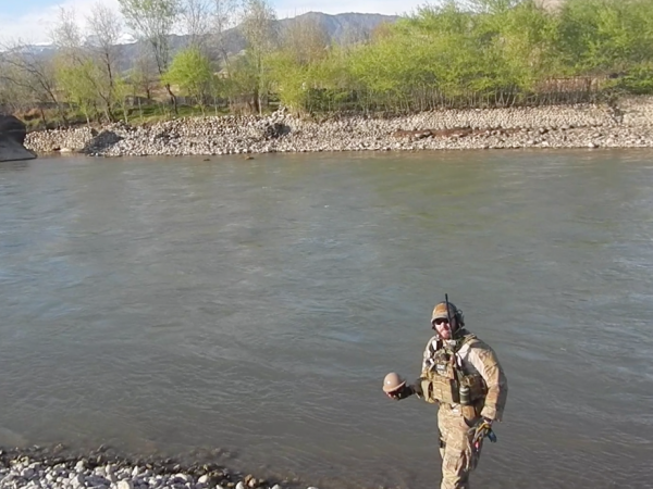 Lance Belobrajdic deploying a River Drifter Hydrology Sensor in Afghanistan in 2013. (Photo courtesy of the U.S. Air Force.)