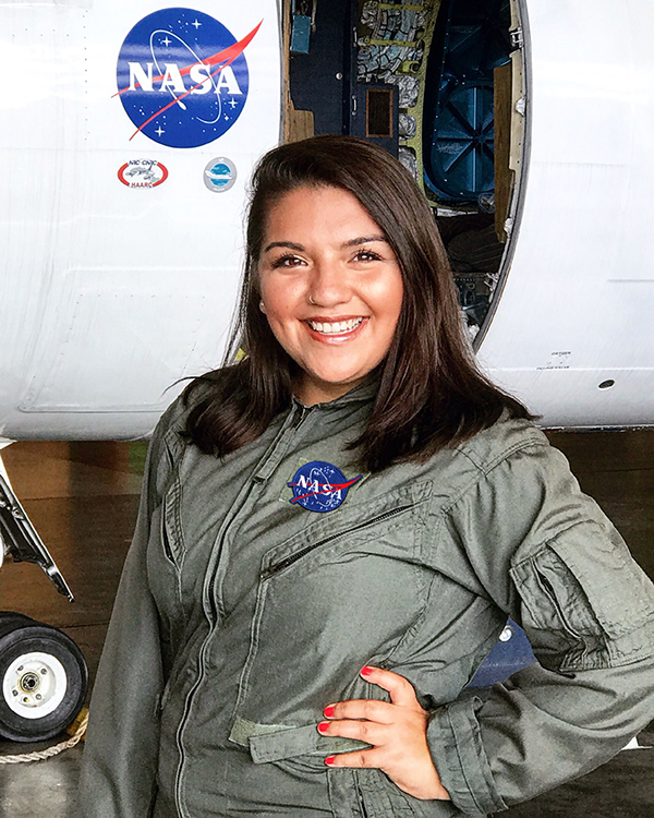Castillo in front of a research aircraft at NASA's Langley Research Center. (Photo courtesy of Ariana Castillo.)