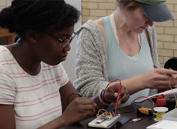Summer 2017 REU participants learn to build a circuit.