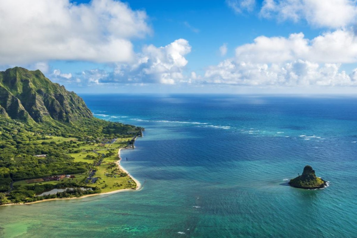Aerial view of Kualoa Point and Chinamans Hat at Kaneohe Bay, Oahu, Hawaii. (Photo from Getty Images.)