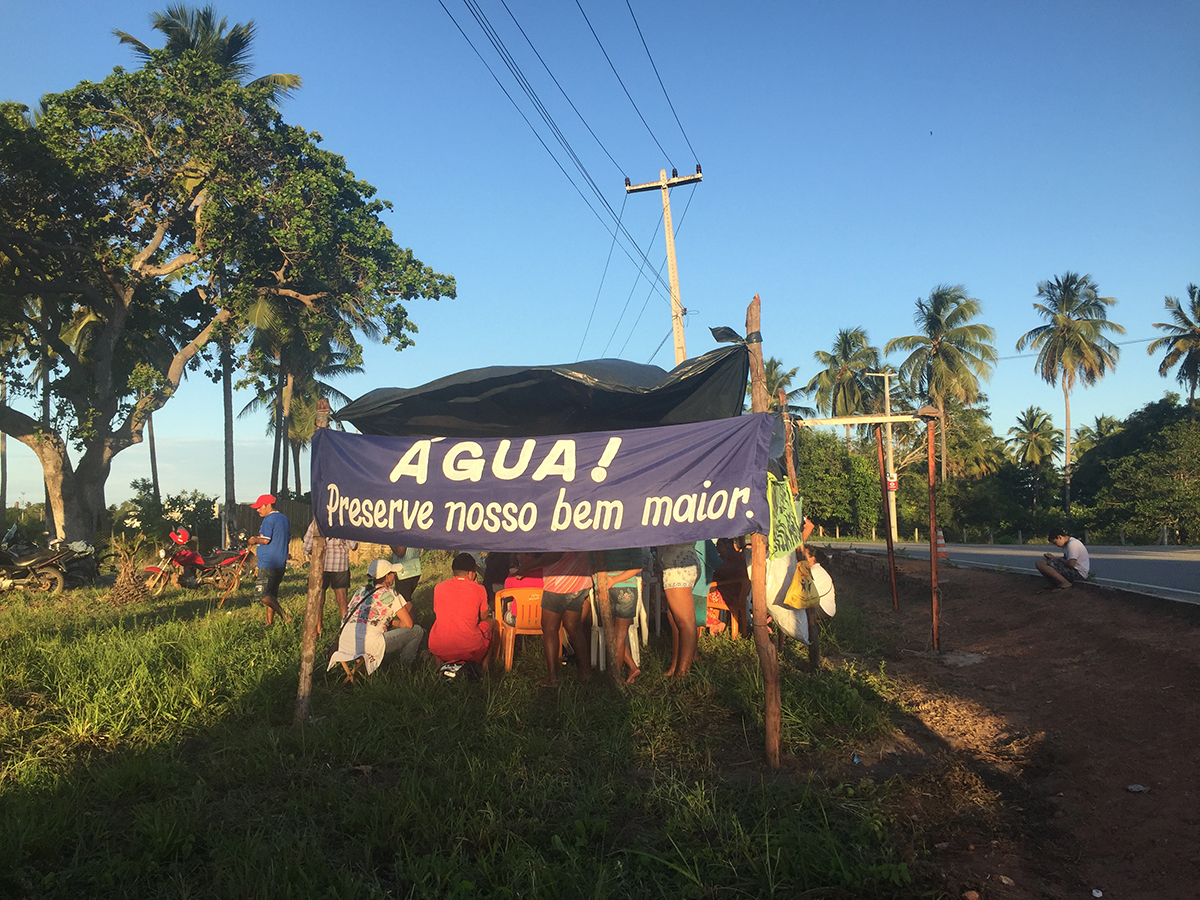 """WATER! Preserve our greatest good,"" reads a banner in Fortaleza, Brazil. (Photo by Flavia Bonolo Dantas, Texas A&M Geography graduate student.)"