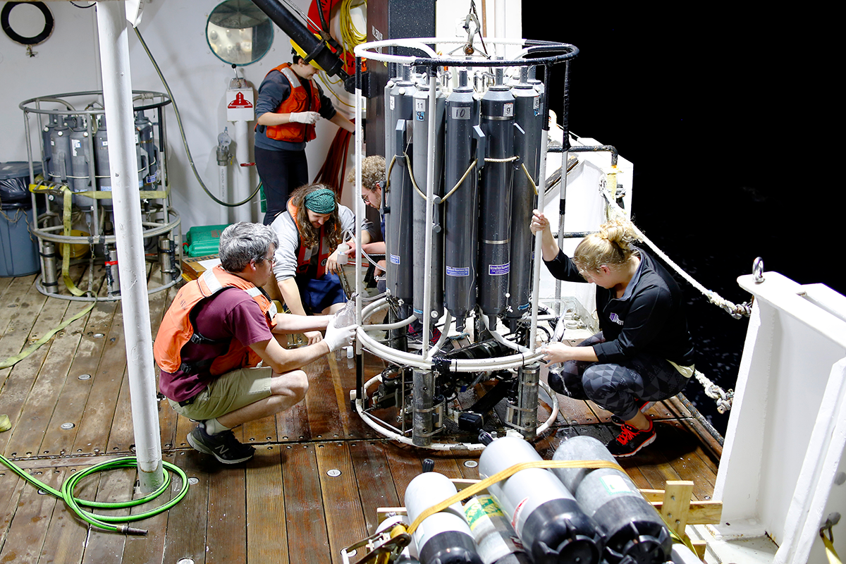 Researchers on the R/V Point Sur manage water sampling equipment. Photo courtesy of Dr. Jason Sylvan.