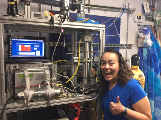 Brianna Hendrickson in front of the Condensation Particle Counter (CPC) located on the Texas A&M instrument rack (Photo courtesy of Dr. Sarah Brooks.)