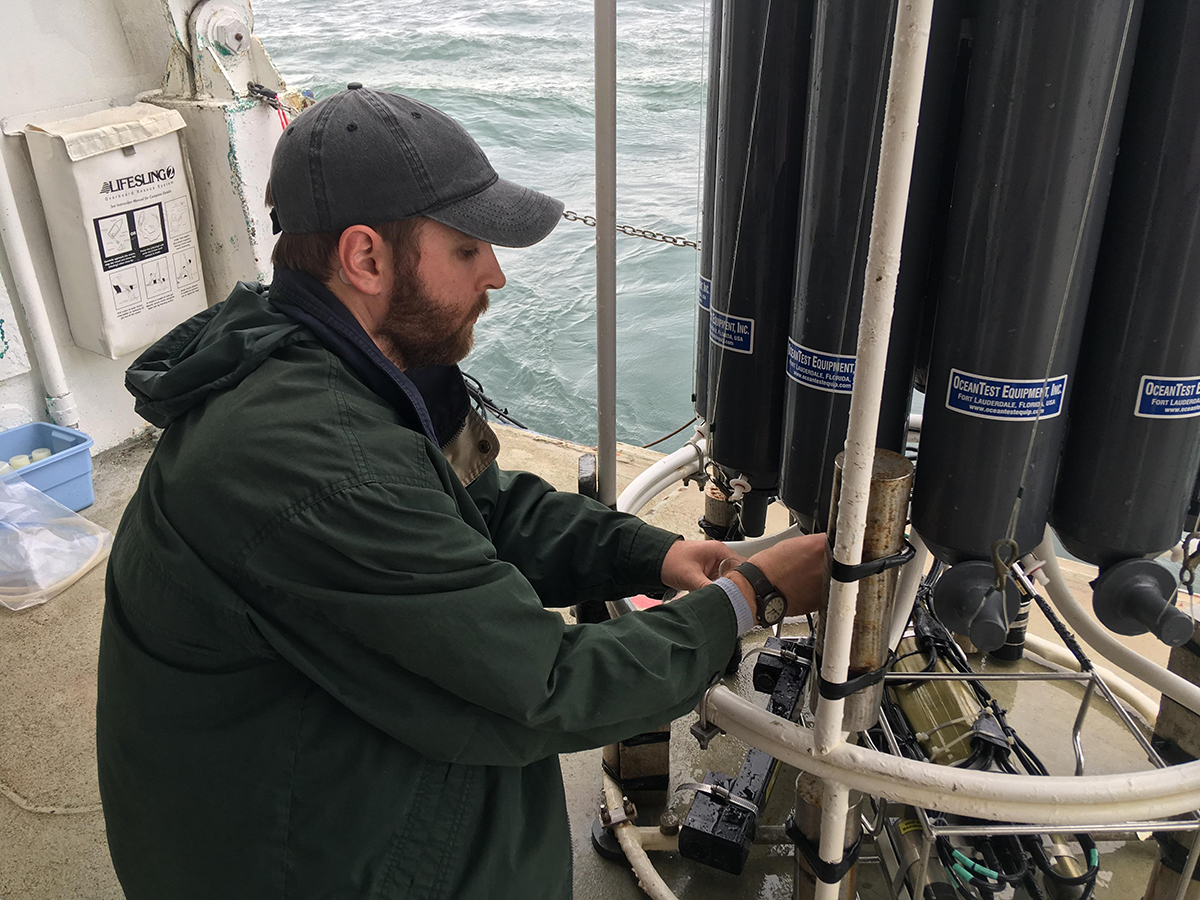 Robert Iles collecting data during a research cruise. (Photo by Robert Iles.)