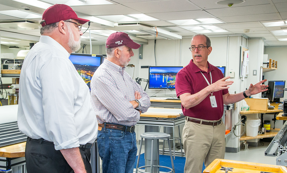 IODP JRSO Director Brad Clement conducts a tour with Vice President Barteau and President Young. (Photo by Tim Fulton, IODP JRSO.)