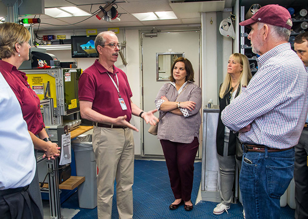 IODP JRSO Director Brad Clement conducts a tour with the Texas A&M delegation, including Geosciences Dean Thomas and President Michael Young. (Photo by: Tim Fulton, IODP JRSO.)