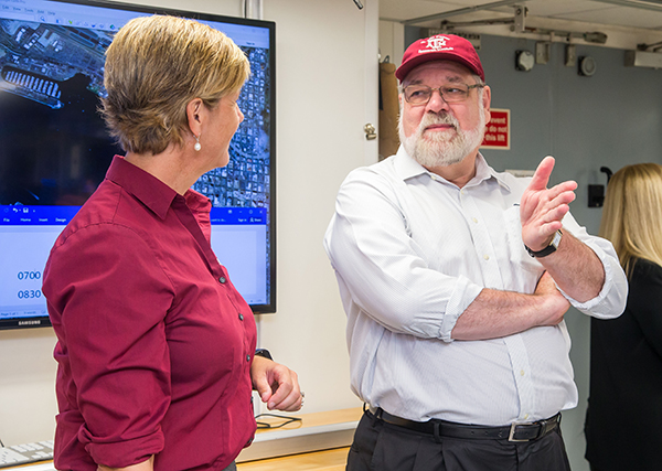 Texas A&M Geosciences Dean Thomas and Vice President Barteau, aboard the JOIDES Resolution. (Photo by: Tim Fulton, IODP JRSO.)