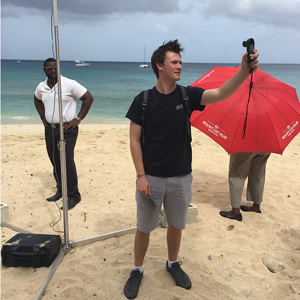 Quinton Lawton on a Barbados beach taking measurements. This took place on a sea-breeze study TAMU students conducted as part of a Meteorology study abroad on the island, in the summer of 2016.(Photo courtesy of Quinton Lawton)
