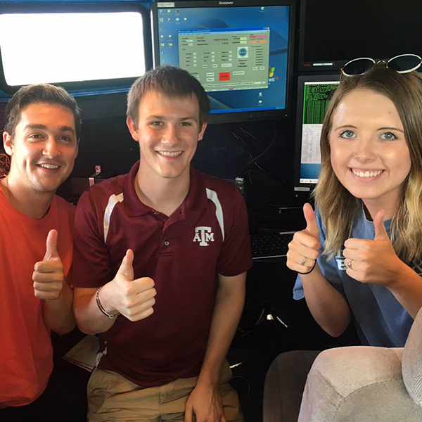 Lawton and fellow Texas A&M meteorology students Ethan Williams (left) and Sarah Randall (right), operating the DOW-8. DOW stands for Doppler on Wheels, a mobile radar truck the department of meteorology used to conduct a field experiment on sea-breeze convection for a few weeks in the summer of 2017. (Photo Courtesy of Quinton Lawton)