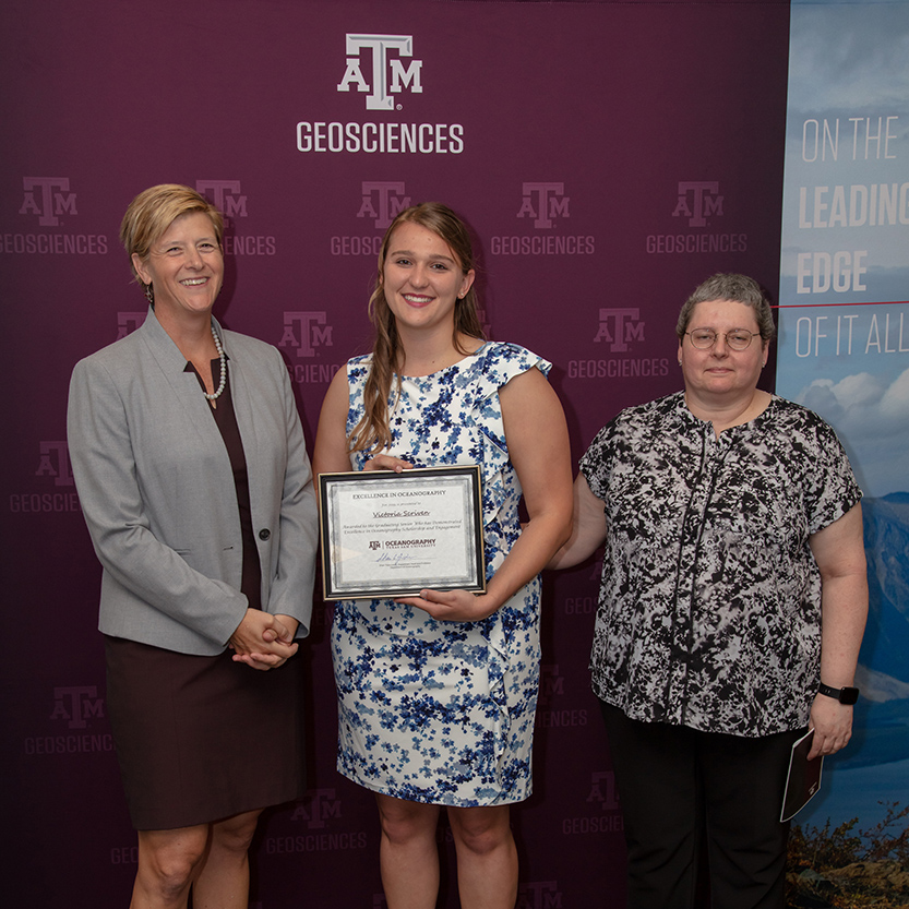 Victoria Scriven receiving the first Excellence in Oceanography Award. Pictured with Dr. Debbie Thomas, dean of the College of Geosciences, and Dr. Shari Yvon-Lewis, Head of the Department of Oceanography. (Photo by Chris Mouchyn, Texas A&M Geoscience)