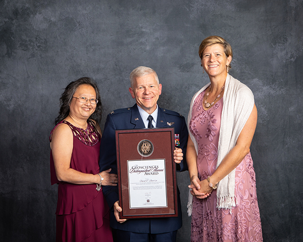 Colonel David E. Bacot '90 received the Geosciences Distinguished Alumni Award; pictured with his wife (left), and Dr. Debbie Thomas.