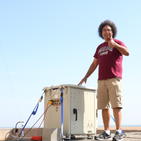 Tim Logan with the CACE LIDAR on top of the Eller O&M Building (Photo by Chris Mouchyn)