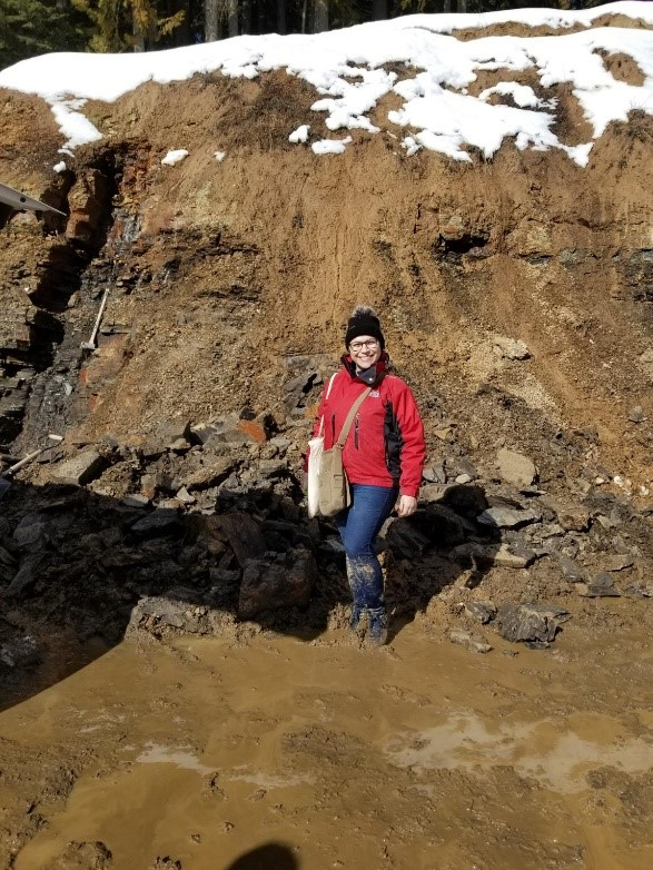 Graduate student, Daianne Höfig, in front of the Clarkia Lake Deposit. (Photo courtesy of Daianne Höfig.)