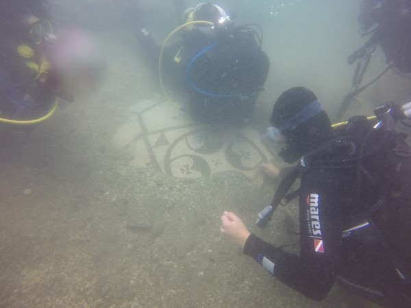 Underwater photograph of the mosaic from a submerged roman villa in the Underwater Archaeological Park. (Photo courtesy of Victoria Scriven)