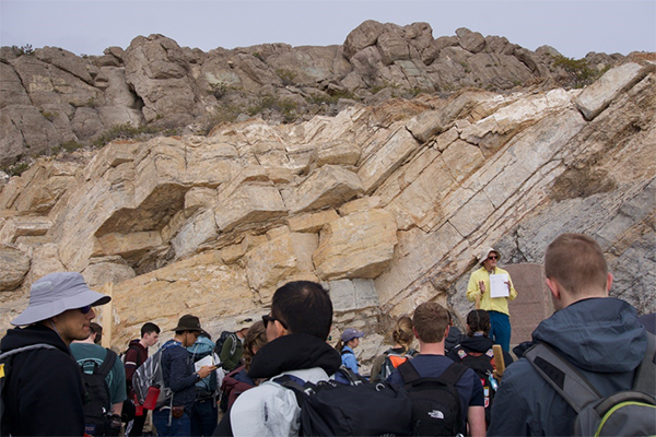 Dr. Mike Pope lectures to students about carbonate stratigraphy in El Paso.