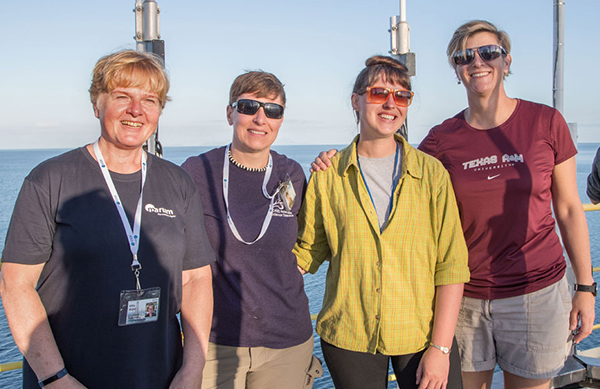 IODP Expedition 378 leadership: Ursula Röhl, Co-Chief Scientist; Lisa Crowder, Laboratory Officer; Laurel Childress, Expedition Project Manager/Staff Scientist; and Debbie Thomas, Co-Chief Scientist, aboard the JOIDES Resolution. (Photo by Tim Fulton, IODP JRSO.)