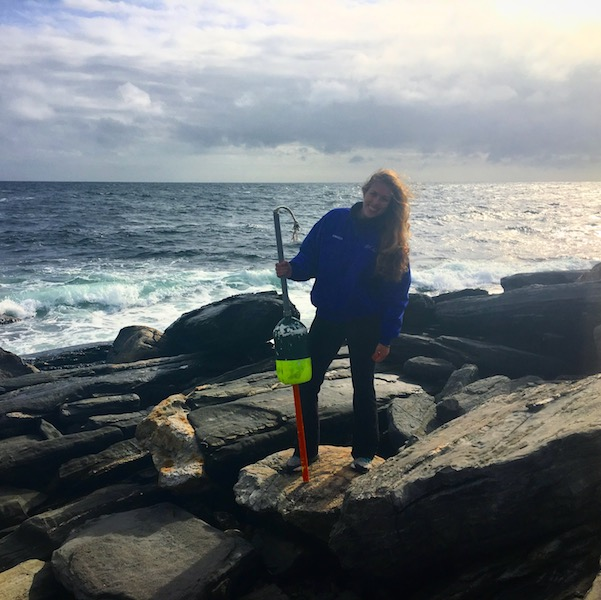 Kimber De Salvo post-wind storm and power outage finding a lobster-pot buoy that had washed ashore from the storm. (Photo Courtesy of Kimber De Salvo)