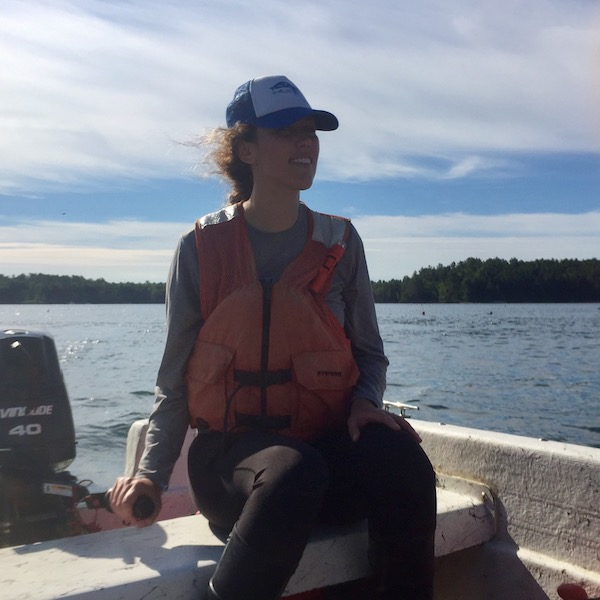Kimber De Salvo in the field in the Damariscotta River Estuary, Maine driving to go collect water samples. (Photo Courtesy of Kimber De Salvo)