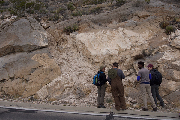 Teaching Assistant David Szafranski instructs students on how to properly measure carbonate stratigraphy in New Mexico. (All photos courtesy of Dr. Nick Perez)