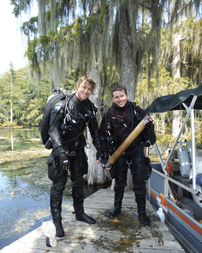 Tyler Winkler (right) and Dr. Pete van Hengstum (left) after collecting a core from Hole in The Wall Cave in Marianna, Florida. (Photo by Meghan Horgan.)