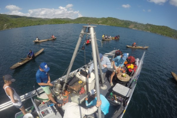 Researchers on the R/V Arenaria garner interest while collecting sediment cores in the Baie des Baradères in Haiti. (Photo by Nicole D'Entremont.)