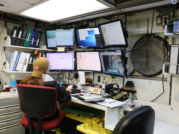Charlotte Miller, working at the CTD console on the R/V Point Sur in Summer 2019 (Photo courtesy of Charlotte Miller.)